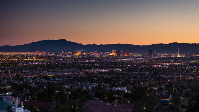 Las Vegas Strip Surrounded by Sprawling Residential Developments - Day to Night Time Lapse