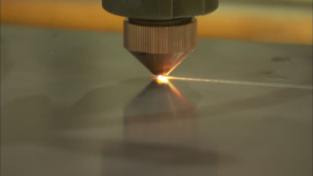 CU TS Laser cutting device cuts rectangle from piece of steel in factory / Livonia, Michigan, USA