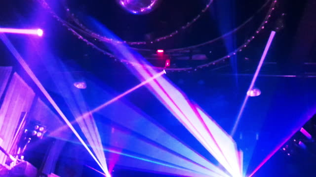 laser disco lights party with flashing at night clubbing - pattaya stock videos & royalty-free footage