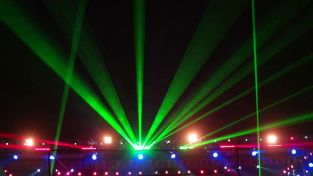 Laser display and light show at a live concert with music and dance during a performance festival