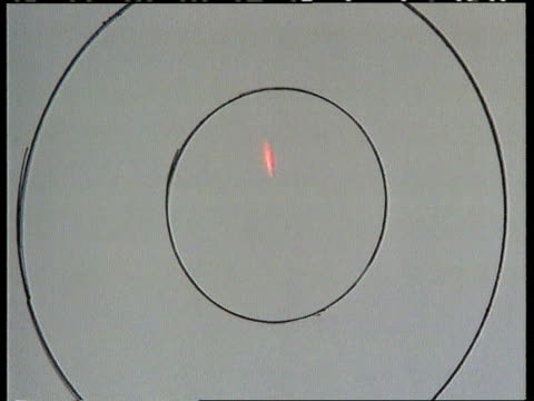 laser guided peashooters:; england: cambridgeshire: int tcs hand holding peashooter l-r other hand holding laser guidance equipment red light from... - direction stock videos & royalty-free footage