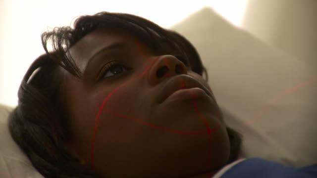 CU Laser guides mapping patient's face into CAT scanner / Burlington, Vermont, USA