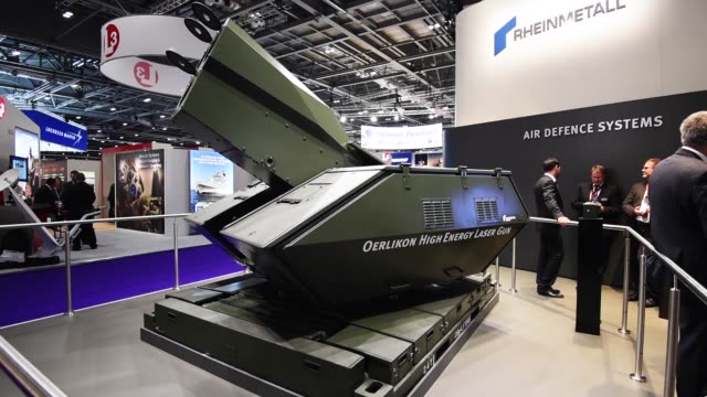laser gun on display at the kmw stand during the defence and security exhibition 2015 at excel on september 15, 2015 in london, england. this year... - security equipment stock videos & royalty-free footage