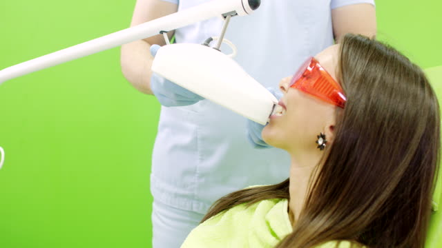 laser teeth whitening procedure - teeth whitening stock videos and b-roll footage