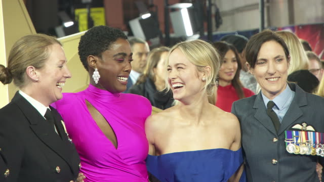 Lashana Lynch Brie Larson and members of the UK Armed Forces at Captain Marvel European Gala on February 27 2019 in London United Kingdom