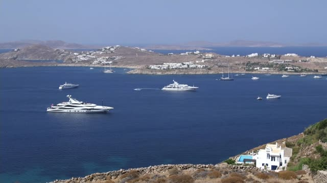 last bhs stores close their doors for the final time t04081610 / tx mykonos high angle shot of bay with superyachts poros 'lionheart' yacht moored... - mykonos stock videos & royalty-free footage