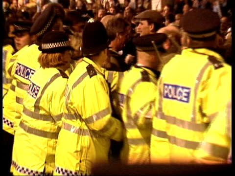 last boxing day meets before possible ban; lib london: westminster at night line of police officers holding back pro-hunting demonstrators pull out... - foxhound stock videos & royalty-free footage