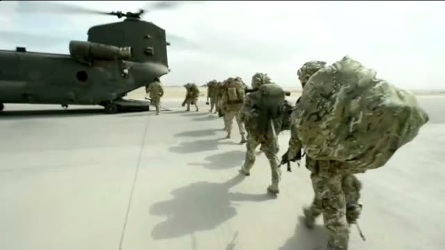 last british troops leave camp bastion / kunduz firefight afghanistan kandahar ext reporter to camera helmand province camp bastion various shots raf... - regiment stock videos & royalty-free footage