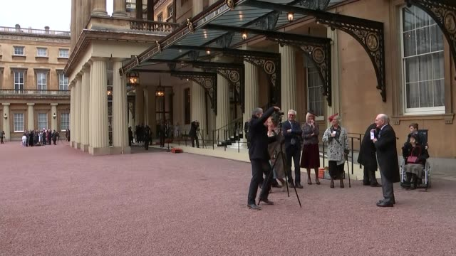 Last Dambuster awarded MBE / Julie Walters made a Dame ENGLAND London Buckingham Palace EXT Julie Walters along / George Johnny Johnson standing with...