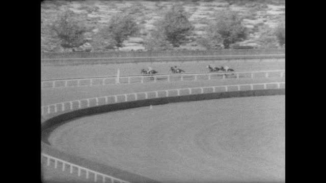 Last few moments of the Woodward Stakes horse race / fans fill the stadium / Damascus leading / Damascus wins easily / Buckpasser comes in second and...
