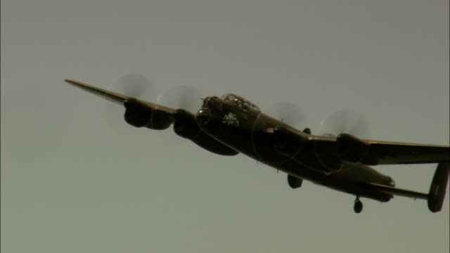 last lancaster bomber in flight  - aerial view - england, leicestershire, melton district, united kingdom - lancaster bomber stock videos & royalty-free footage