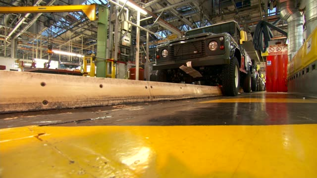 last land rover defender production line; england: midlands: solihull: int land rover defender production line / orange defender / production line /... - land rover stock videos & royalty-free footage