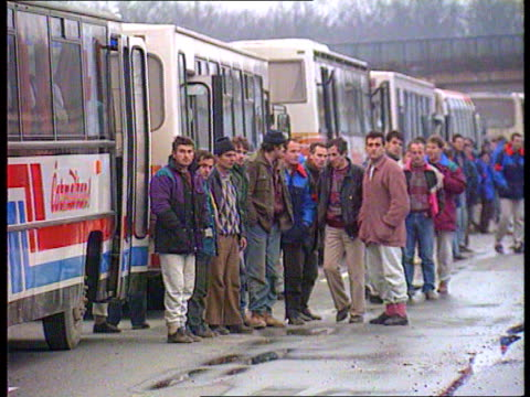 last muslim detainees released from manjaca detention camp bosnia herzegovina ext tgv line of red cross coaches carrying released muslim prisoners... - bosnia and hercegovina stock videos & royalty-free footage