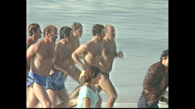 stockvideo's en b-roll-footage met last night sheraton wentworth sydney – prince charles and princess diana dancing / royals leave ball / today bondi beach – prince charles in surf /... - 1983
