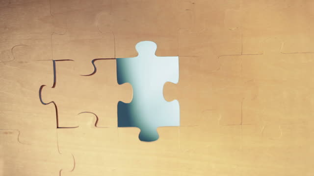 last pieces of puzzle - jigsaw puzzle stock videos & royalty-free footage