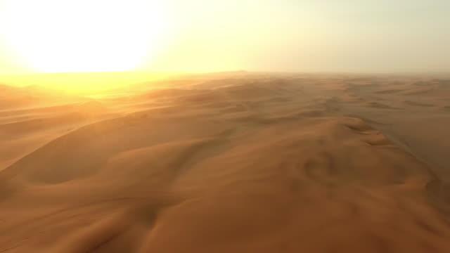 Derniers rayons de la lumière au-dessus du désert namibien