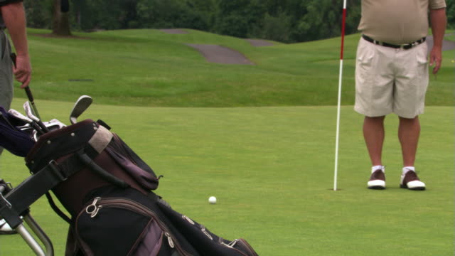 last stroke for the hole - see other clips from this shoot 1271 stock videos and b-roll footage