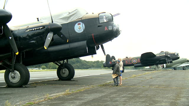 last two 'flying' lancaster bombers at biggin hill; england: bromley: london biggin hill airport: ext flight sergeant bob gill interview sot cutaways... - biggin hill stock videos & royalty-free footage