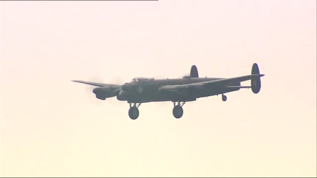 last two 'flying' lancaster bombers reunited in lincolnshire england lincolnshire raf coningsby ext canadianbased wwii lancaster bomber landing at... - lancaster bomber stock videos & royalty-free footage