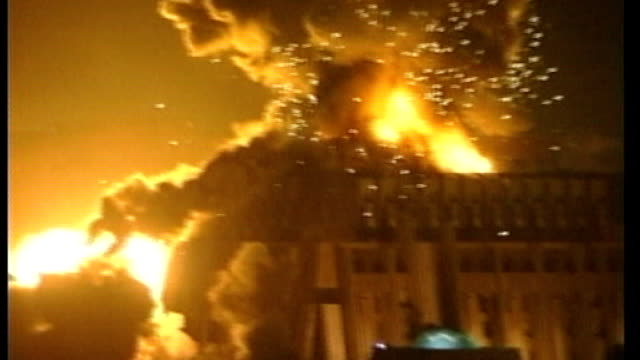 last us combat brigade pulls out of the country lib buildings exploding into flames and smoke rising into air during 'shock and awe' bombing of... - 2010 video stock e b–roll