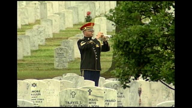 barack obama speech tx usa virginia arlington arlington cemetery american soldier playing last post in heavy rainfall coffin of maria ortiz general... - iraq stock videos and b-roll footage
