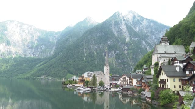 last year hallstatt opened its door to more than one million visitors but covid19 changed everything for the 780 locals of this austrian village - österreichische kultur stock-videos und b-roll-filmmaterial