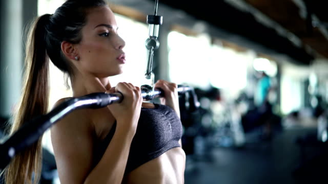 lat pull down exercise at gym - leggings stock videos & royalty-free footage