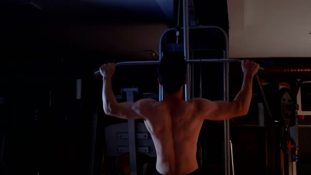 lat pulldown machine man workout at gym - lateral pull down weights stock videos & royalty-free footage