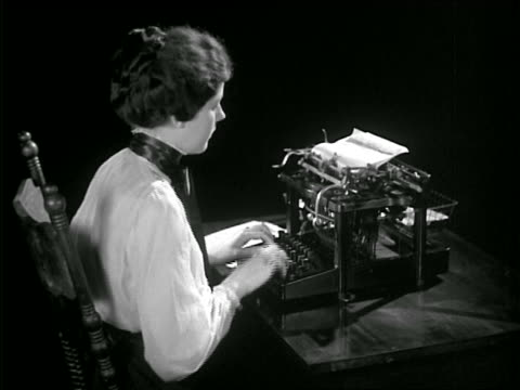 B/W late 1800s REENACTMENT woman typing on early typewriter