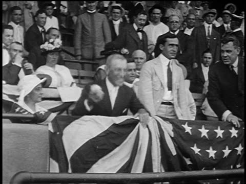 B/W late 1910s Woodrow Wilson standing up in stadium throwing first baseball of the season