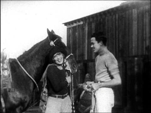 b/w late 1920s celebrity couple posing with horse at hearst's san simeon estate / documentary - herbivorous stock videos & royalty-free footage