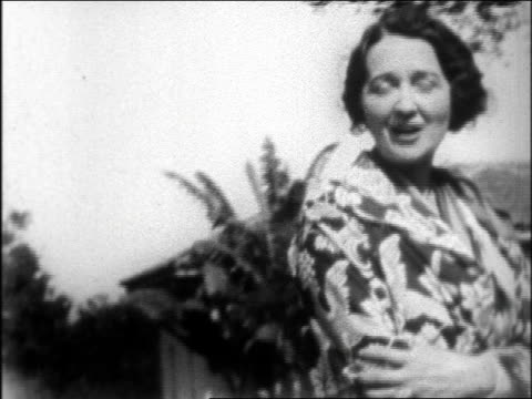 late 1920s gossip columnist hedda hopper smiling + posing with a. giannini at san simeon / doc. - columnist stock videos & royalty-free footage