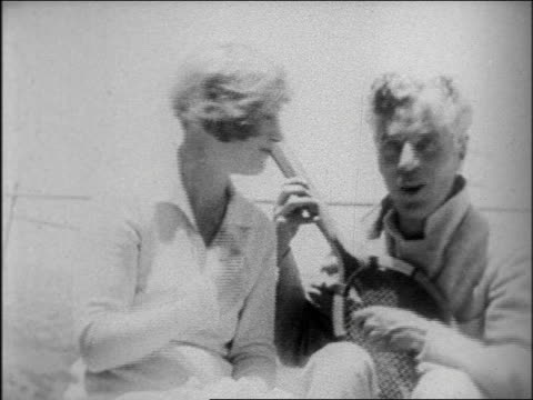 vídeos de stock, filmes e b-roll de b/w late 1920s marion davies charles chaplin playing with tennis racket / san simeon / documentary - charlie chaplin