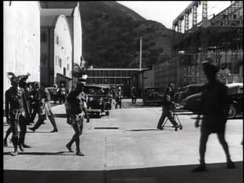 late 1930's rear pov through the warner bros. lot from moving automobile - warner bros stock videos & royalty-free footage