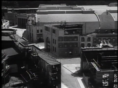 late 1930's pan showing warner bros sound stages and movie lots - workshop stock videos & royalty-free footage