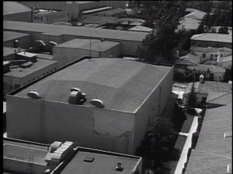late 1930's pan showing warner bros sound stages and movie lots - warner bros stock videos & royalty-free footage