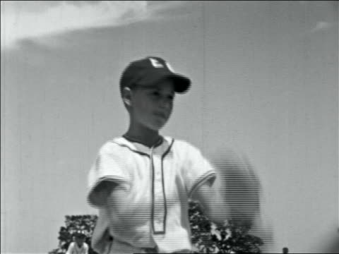 stockvideo's en b-roll-footage met late 1950s boy in uniform pitching in little league game - baseball uniform