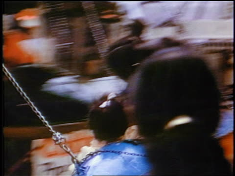late 1950s pan children on spinning airplane ride at carnival / newsreel - 1950 stock videos & royalty-free footage