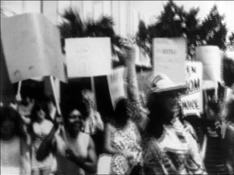 B/W late 1960s tilt down women marching in abortionrights rally / newsreel
