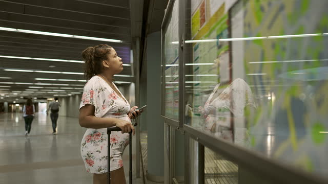 late 20s pregnant passenger checking subway infographic - maternity wear stock videos & royalty-free footage