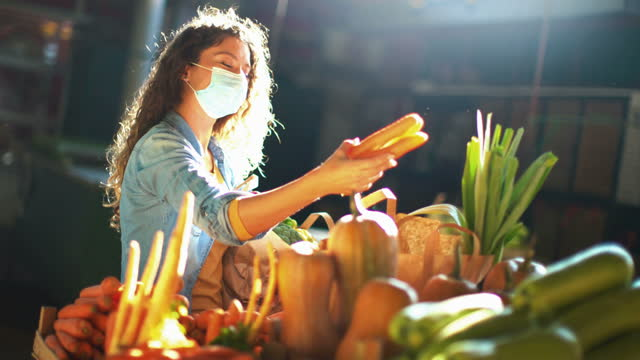 late 20's woman going grocery shopping after business reopened during coronavirus pandemic - farm produce market stock videos & royalty-free footage