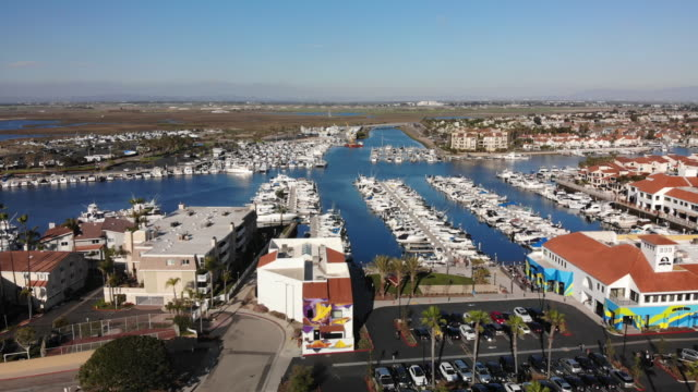 late afternoon drone footage of huntington harbour in southern california los angeles close to the pacific ocean and huntington beach - route 001 stock videos & royalty-free footage