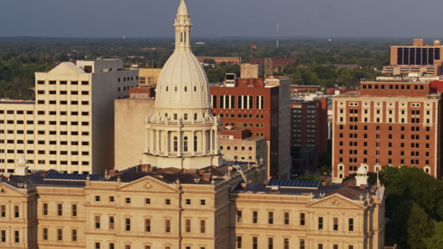 late afternoon light on the michigan state capitol - lansing stock videos & royalty-free footage