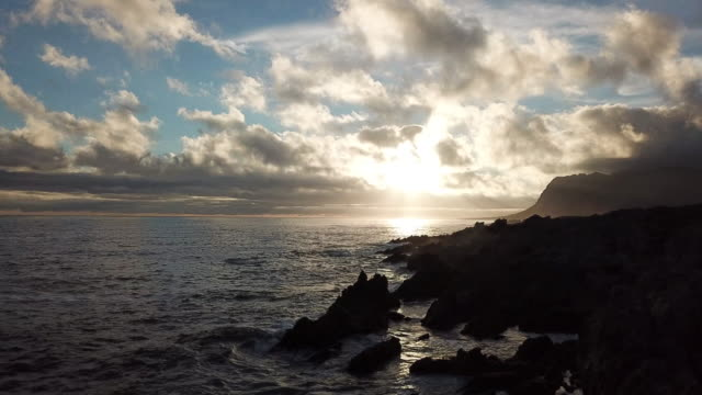 late afternoon sun set over the ocean - butte rocky outcrop stock videos and b-roll footage