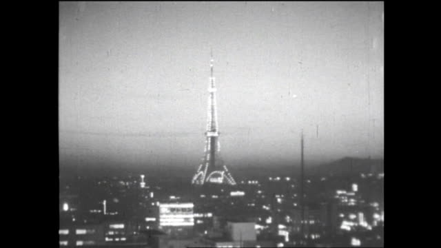 late december night view of just completed tokyo tower and illuminated cityscape of tokyo - 1950~1959年点の映像素材/bロール