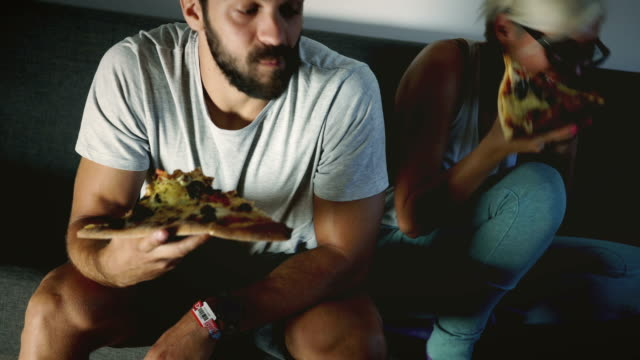 late night dining pizza slice - sofa stock videos & royalty-free footage