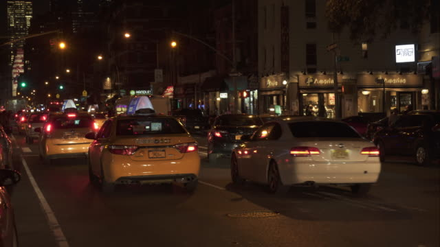 late night new york city street traffic - taxi stock videos & royalty-free footage