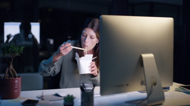 late nights need a lot of fuel - bacchette cinesi video stock e b–roll