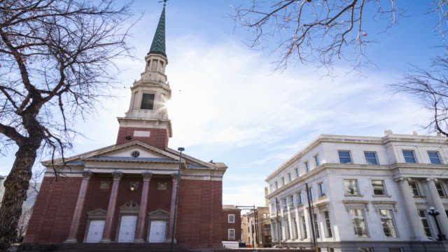 a late winter afternoon time lapse of the first baptist church of denver with the sun making a dramatic appearance from behind the steeple - steeple stock videos & royalty-free footage