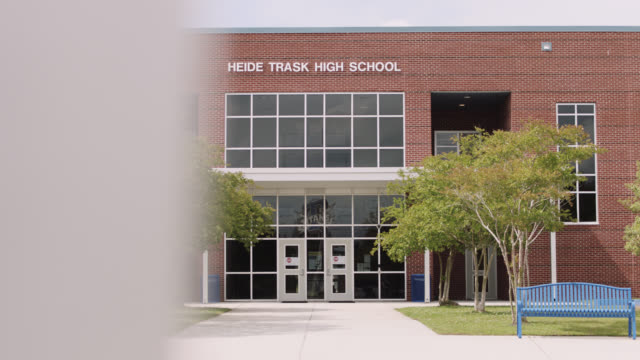 lateral tracking shot of an empty high school entrance. - brick stock videos & royalty-free footage